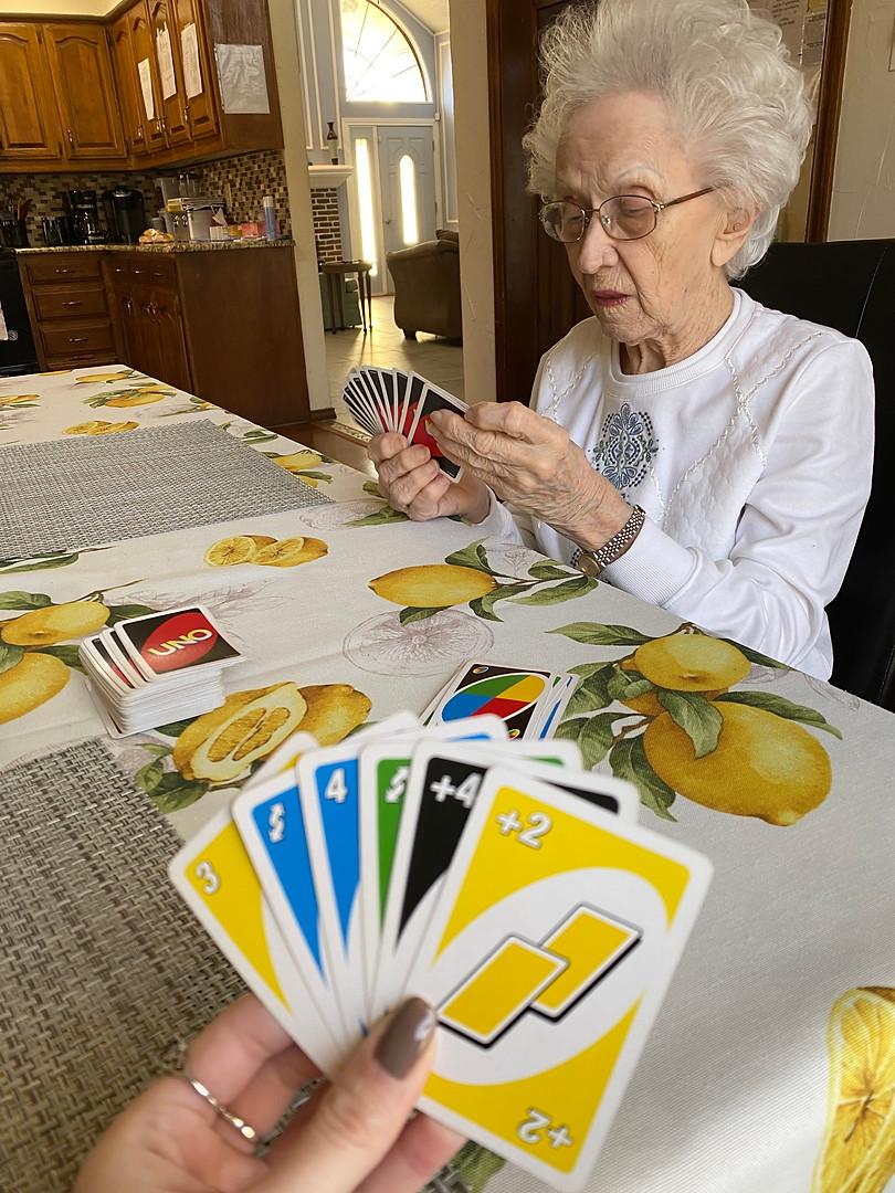 Senior playing Uno