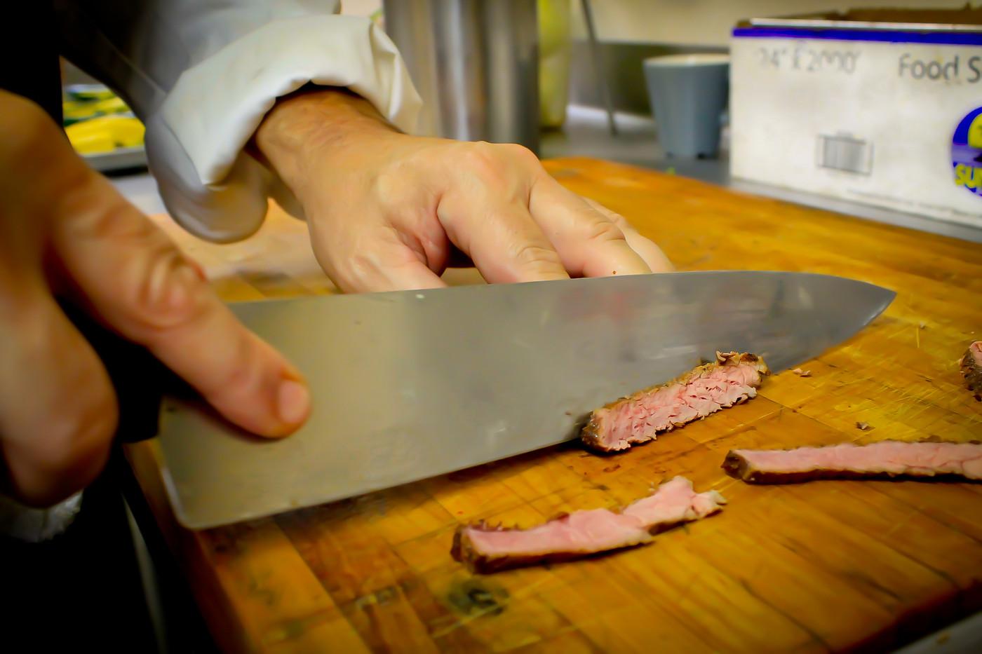 4 seasons chef cutting meat.jpg