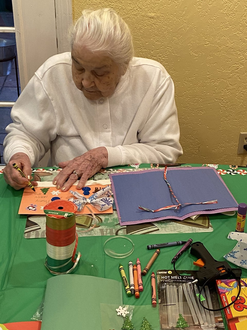 Senior making Christmas card