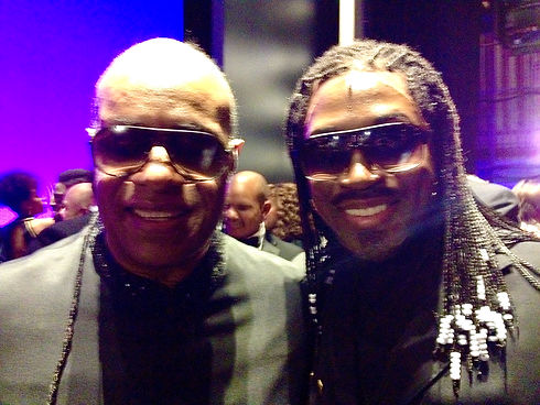 Elijah Ahmad Lewis as Stevie Wonder with Stevie Wonder