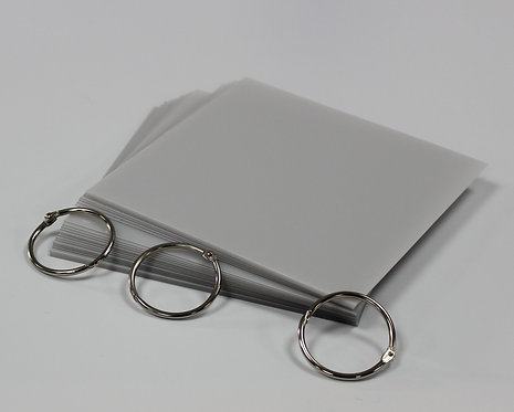 """6"""" x 6"""" clear album kit * image shows protective covering on plastic sheets."""