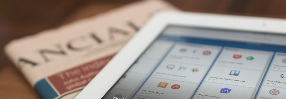 Tablet on a newspaper_edited.jpg