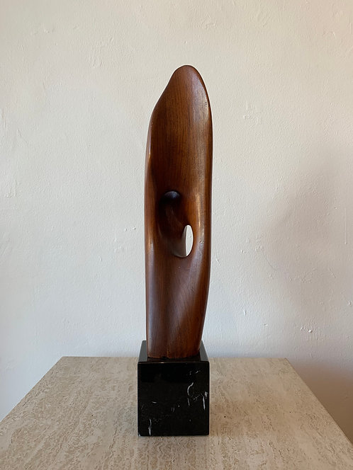 abstract wooden sculpture on marble