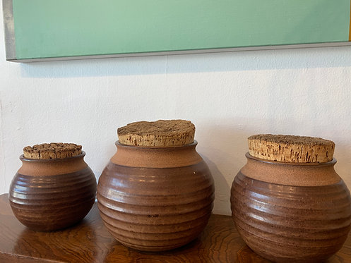 set of three vintage ceramic canisters with cork