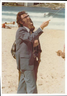 Mayor Ernie Page flying a kite at the 1978 festival. John Silk is to the left.