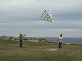 A tetrahedral kites is a most uncommon kite and this is a friend and I launching a kite we made together. From Michael Richards (AKS)