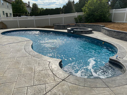 Stamped concrete w spillover