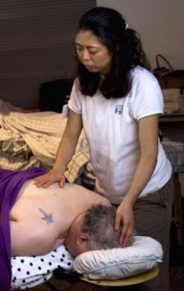 CNg giving Reiki to a cancer patient circa Fall 2016