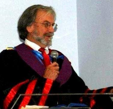 Dr. Meyer ministering at a graduation ceremony