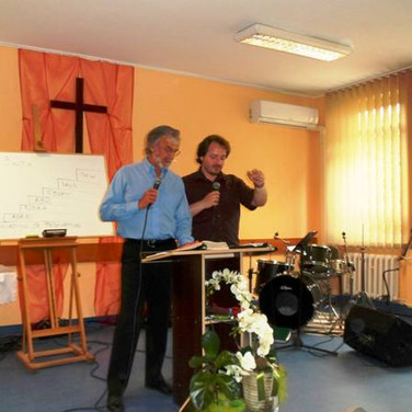 Preaching in Poland with the pastor translating into Polish