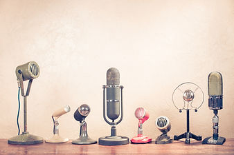 Retro old microphones on table.jpg