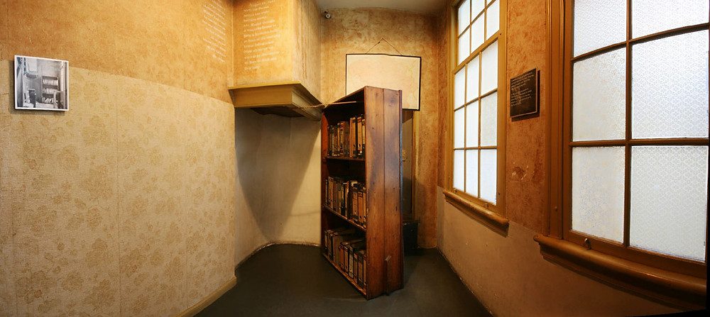 The famous bookcase, leading to the attic in Anne Frank's house.