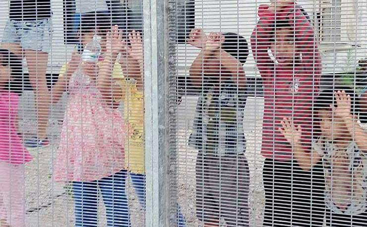 Children against fence on Manus detention centre