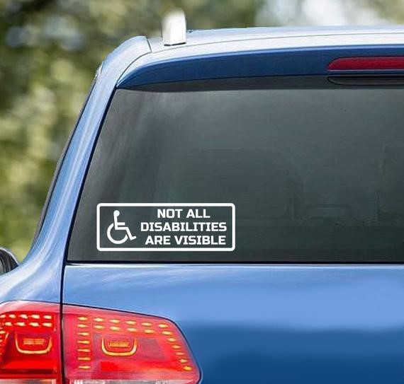 Blue car with sticker 'not all disabiliites are visible'
