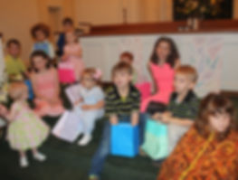 Children gathered in the front of the sanctuary