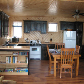 The kitchen in Solace Cottage. There is a bookcase in each cottage with books and games.