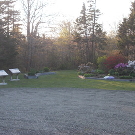 The gardens and parking area at the Maud Lewis home.