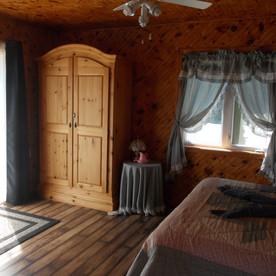 The queen bedroom in Tranquity Cottage has a patio door.