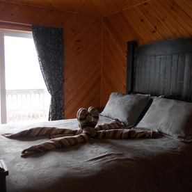 The queen bedroom.  All the wood furniture in Solace is handmade.