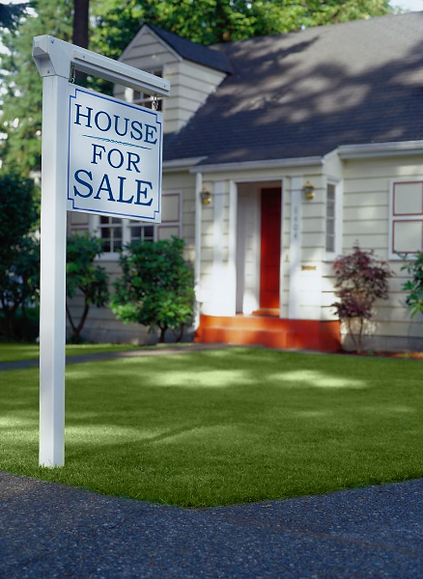 House with a for sale sign in front yard