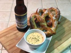 Beer cheese dip pretzel