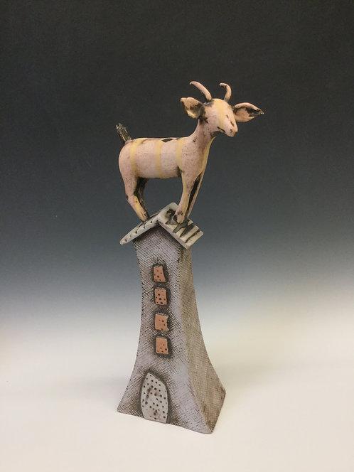 Large goat on house