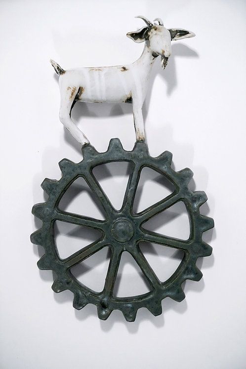 Pale goat on wankel with green patina finish