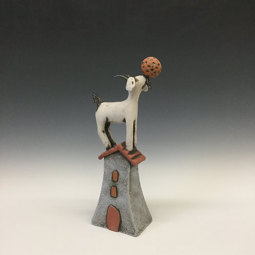 Small Goat on House with Ball