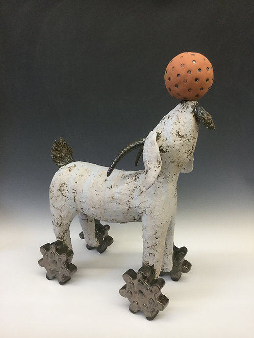 Goat with wheels and orange ball