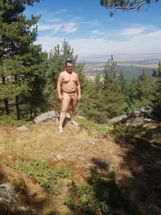 Nude up a mountain