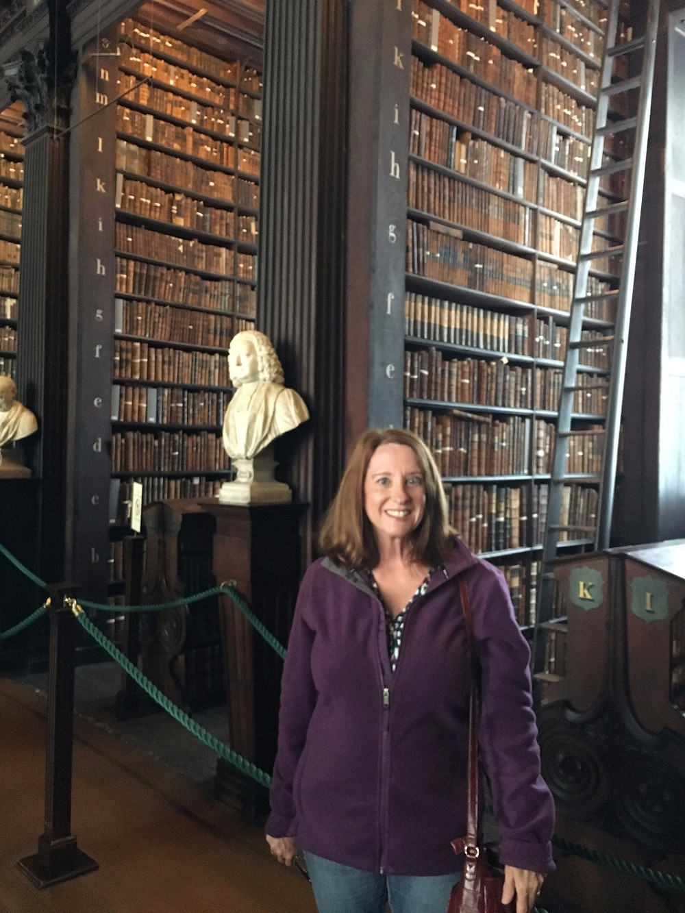Me at the Trinity College library in Dublin, Ireland. See? Books make me happy.