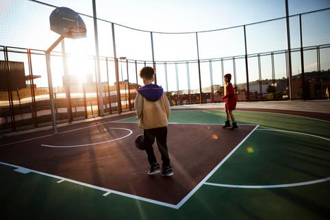 children-playing-basketball-field.jpg