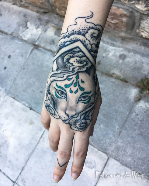 kitsune fist tattoo