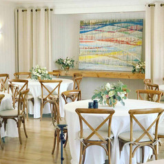 Cross back chairs and simple linens