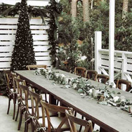 Reception with Farm Tables  Farm tables and crossback chairs for the wedding party from Soho Rentals.