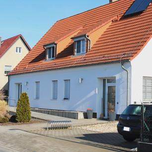 _Alte Sparkasse_ Mehrfamilienhaus mit Bü