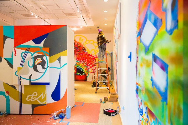 Artists painted canvases and walls Jan. 11 at the new Art Ventures Gallery in Menlo Park, which is due to open Feb. 1.  Photo by Michelle Le/The Almanac.)
