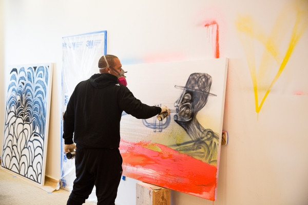 San Rafael artist Chor Boogie works on his piece at Art Ventures gallery on Jan. 11, 2017. Photo by Michelle Le