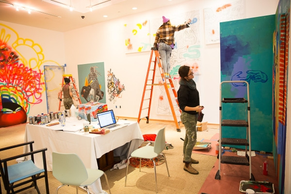 Oakland artist Lynnea Holland-Weiss, right, works on her installation along with fellow artists at Art Ventures gallery on Jan. 11, 2017. Photo by Michelle Le