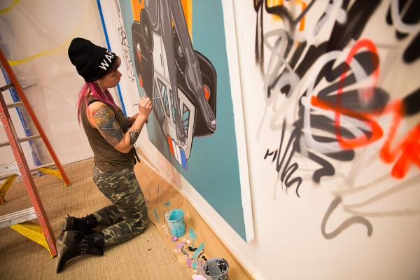 "Oakland artist Nina Wright a.k.a. Girl Mobb works on her piece ""Love is the Law with Venus"" at Art Ventures gallery on Jan. 11, 2017. Photo by Michelle Le"