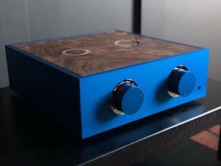 Blue pre-amplifier with chrome trim and a burr walnut lid