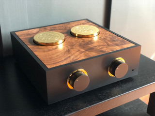 Black pre-amplifier with gold trim, tall gold plated brass cowls and a burr walnut cutout lid