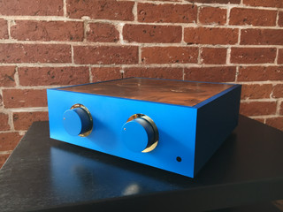 Blue pre-amplifier with gold trim and a burr walnut lid
