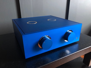 Blue pre-amplifier with gold trim and a blue metal lid