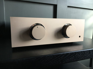 Light champagne pre-amplifier with chrome trim and a light champagne metal lid