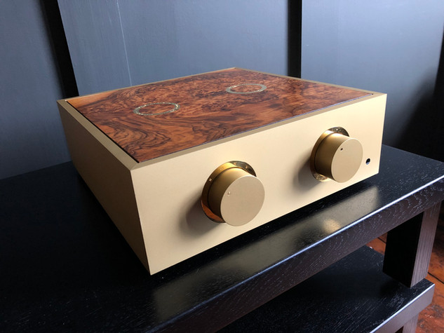 Champagne pre-amplifier with gold trim and a walnut burr lid