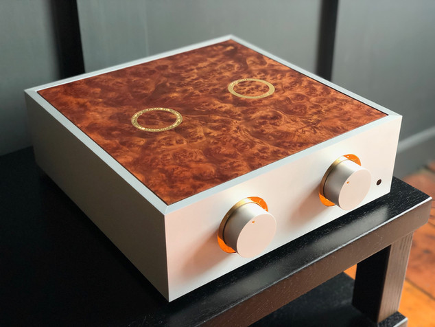 Natural pre-amplifier with gold trim and a camphor burr lid.