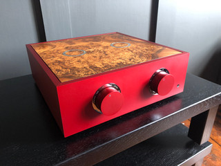 Ruby Woo red pre-amplifier with chrome trim and a burr walnut lid
