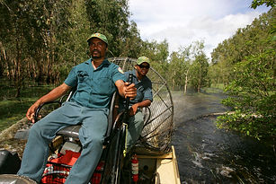 Fred Hunter piloting an Airboat around K