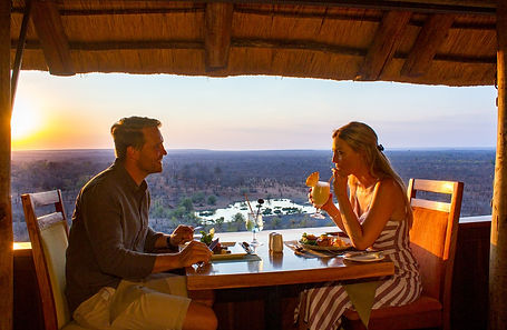 Guests enjoying dinner at Victoria Falls